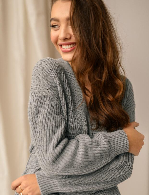 Girl in grey sweater