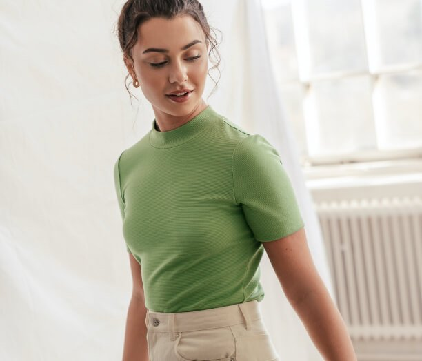 Girl wearing green t-shirt with short sleeves