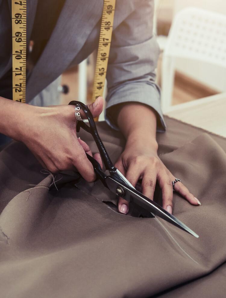 Woman cutting fabric