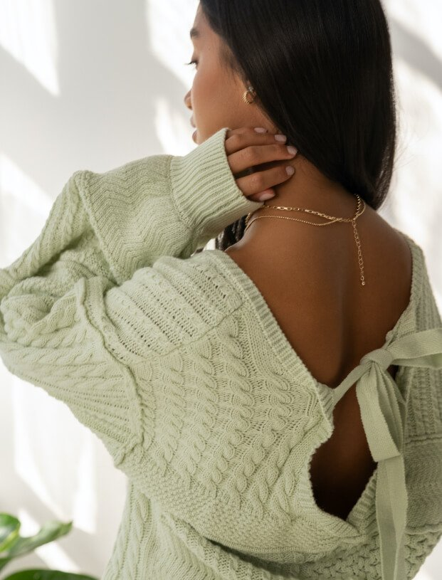 Girl in white sweater